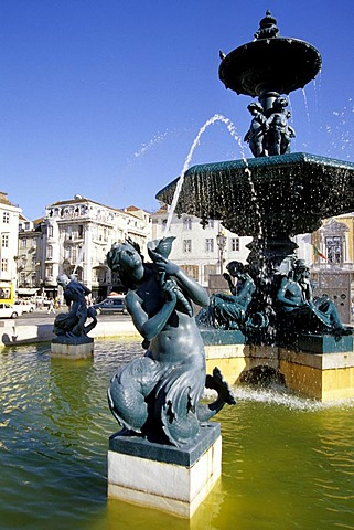 Fountain with sculptures on Rossio Square, Praca de Dom Pedro IV, old city, Lisbon, Portugal, Europe
