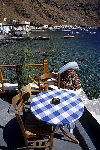 Bar cafe restaurant terrace in the harbour of Manolas, Korfos, in the Nikolaos Bay, Santorini, Thera or Thira, Island of Thirasia, Therasia, Cyclades, the Aegean, Mediterranean Sea, Greece, Europe