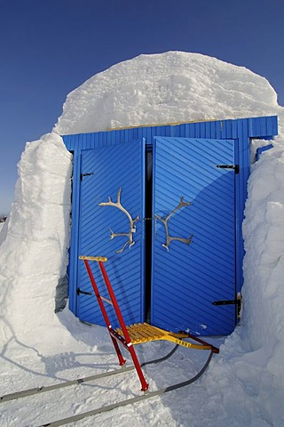 Entry doors to the igloo-hotel with caribou-antlers and sledge, Snow Hotel, Kirkenes, Finnmark, Lapland, Norway, Scandinavia, Europe