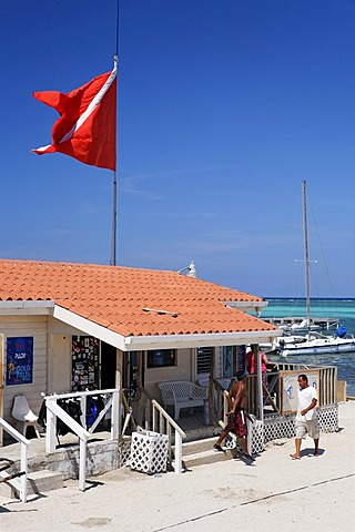 Diving flag over the scuba diving center at the Sun Breeze Hotel, San Pedro, Ambergris Cay Island, Belize, Central America, Caribbean