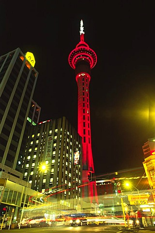 Sky Tower by night illuminated red, Auckland, North Island, New Zealand