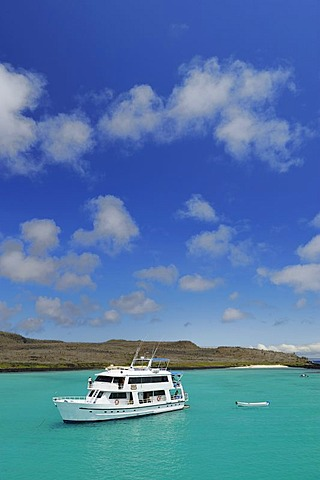 Boat in the snorkling paradise in the bay of Santa Fe Island, Galapagos Islands, Ecuador, South America