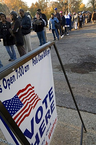 People stand in long lines waiting to vote at Salem Memorial Lutheran Church on Election Day in the 2008 Presidential election, Detroit, Michigan, USA