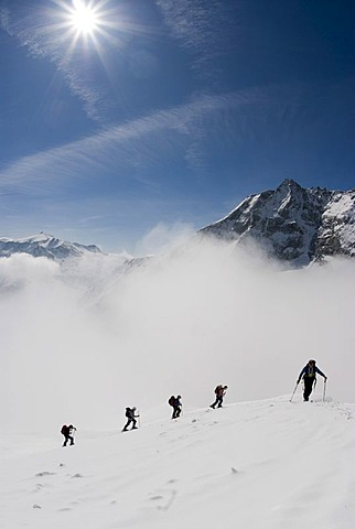 Ski tour in Rauris with Mt. Sonnblick, 3105m, at back, Hohe Tauern National Park, Salzburg, Austria, Europe