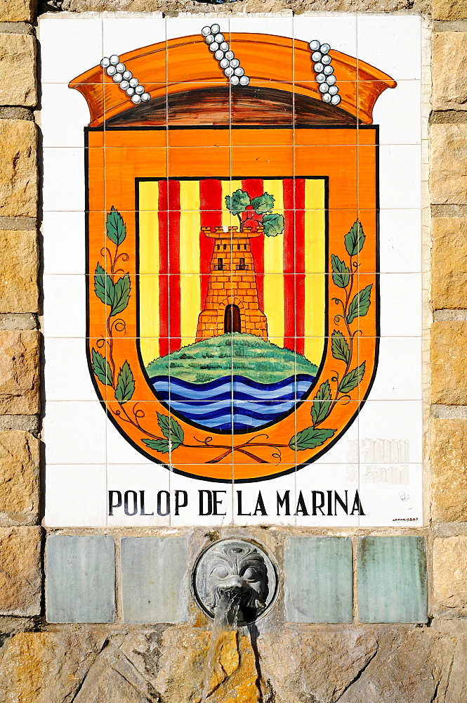 Fountain decorated with tiles painted with the coat of arms of Polop de la Marina, Alicante, Costa Blanca, Spain