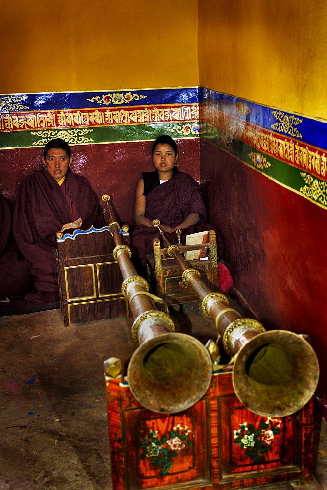 Tibetan nuns with traditional trombones, Sangngag Simkyil Nunnery, Tibet