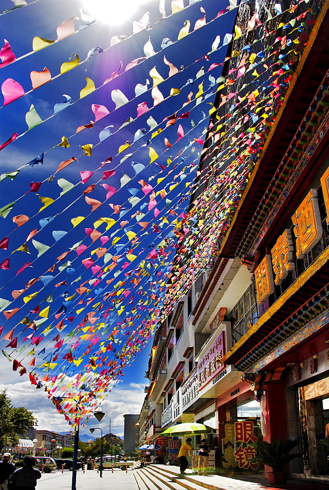Flags at a supermarket, Lhasa, Tibet