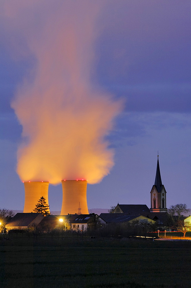 Grafenrheinfeld Nuclear Power Plant next to the church steeple of Roethlein, Lower Franconia, Bavaria, Germany, Europe