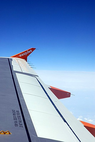 Wing of an easyjet airplane during the flight, travel
