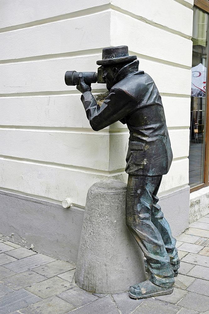 Paparazzi, bronze figure, Bratislava, Slovakia
