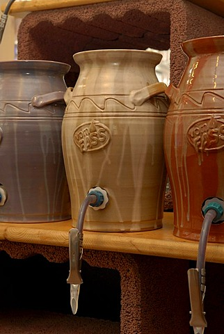 Storage of oils and vinagars in jars