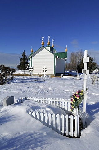 Russian-orthodox church with cemetery in winter in Ninilchik, Kenai Peninsula, Alaska, USA, North America