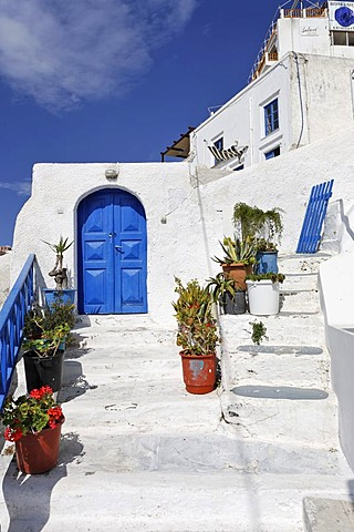 House entrance with a door painted in greek blue, Thira, Santorini, Greece
