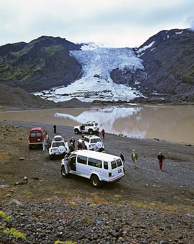 Four wheel drive cars and a glacier lake behind the Gigjoekull glacier, Thorsmoerk, Iceland