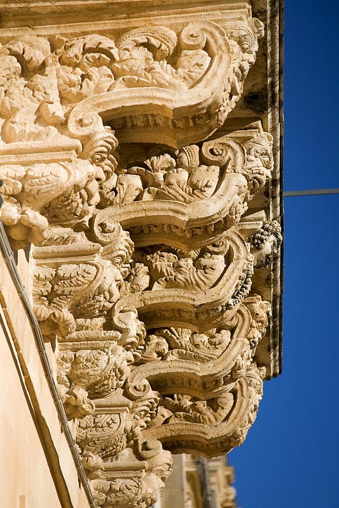 Baroque balcony in Noto, Sicily, Italy