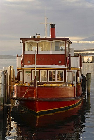 Boat illuminated by warm morning light in the harbor of Hobart, Tasmania, Australia