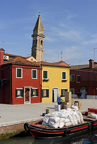 Colourfully painted houses and the leaning tower of the Church of St. Martino at a canal on Burano, an island in the Venetian Lagoon, Italy, Europe