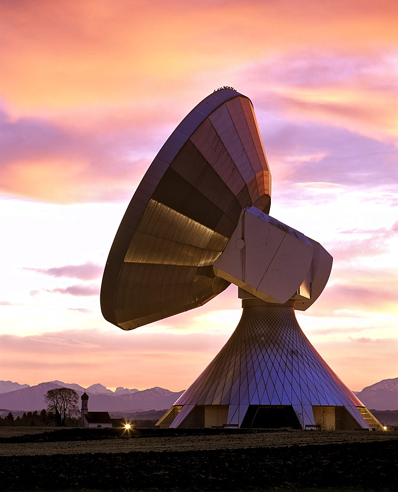 Dawn, lit antennas of the ground communication station Raisting, St. Johann Kapelle (Chapel) and Alps, Upper Bavaria, Germany