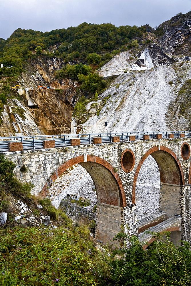 Stone bridge in the marble stone pit of Carrara Tuscany Italy