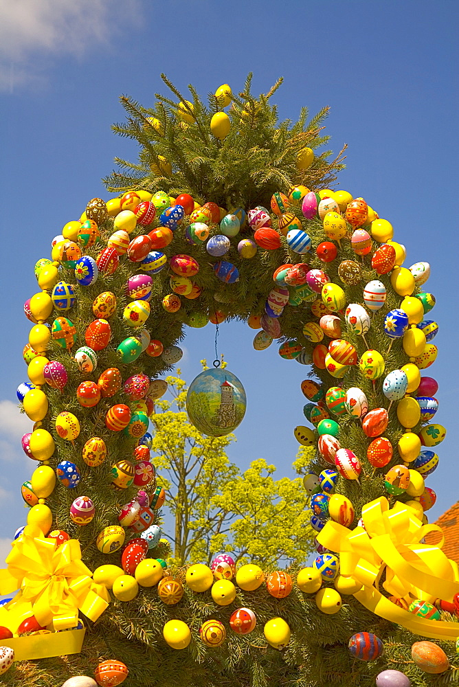 Easter fountain, top with coloured eggs, Waischenfeld, Franconian Switzerland, Bavaria, Germany, Europe