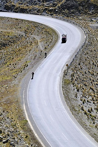 Mountainbikers descending an S-curve, Downhill Biking, Deathroad, Altiplano, La Paz, Bolivia, South America