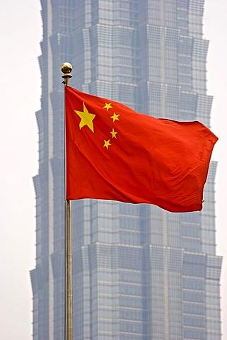Asia, china, shangahi, jin mao tower with chinese flag.