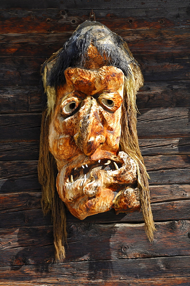 Traditional wooden mask made of Swiss pine wood, Wiler, Loetschental, Valais, Switzerland