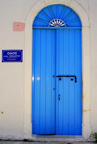 Blue front door, street sign, Fiscardo, Kefalonia, Ionian Islands, Greece