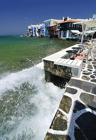 Wave crashing on the promenade along the port of Little Venice, Mykonos Island, Cyclades, Greece, Europe