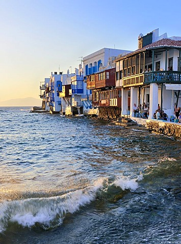 Surf with waves at the beach near Little Venice in the final evening light, Mykonos, Cyclades, Greece, Europe