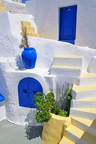Inner courtyard with blue and yellow elements and a stairway in a typical cycladic architecture style, Oia, Ia, Cyclades, Greece, Europe