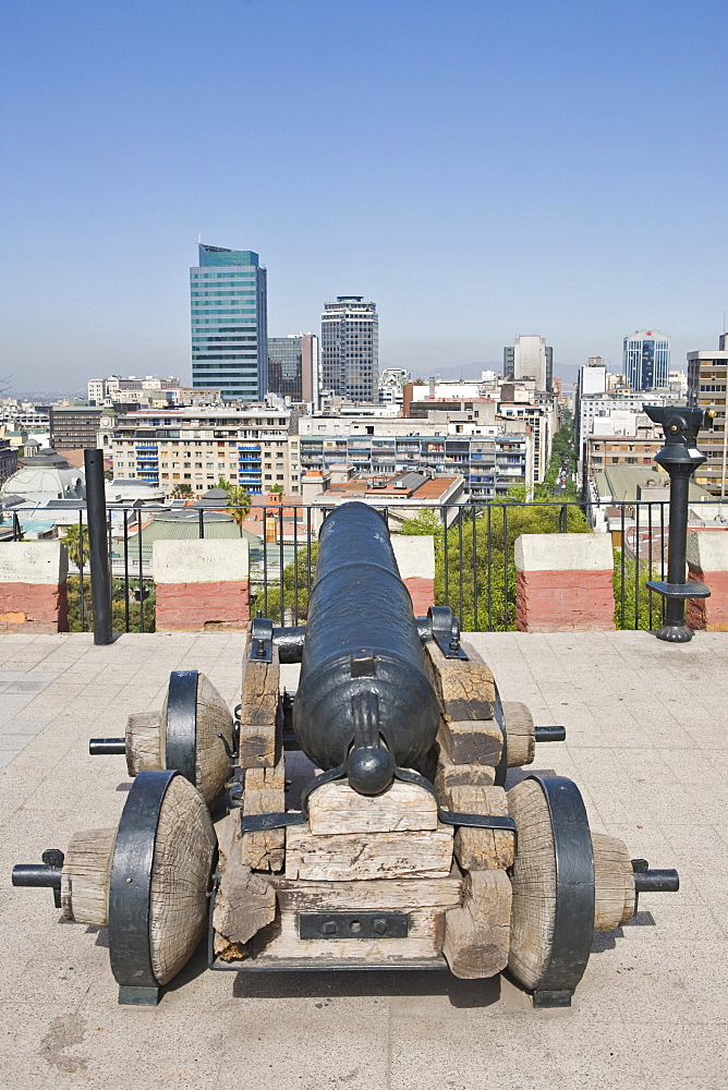 Old canon aimed in the direction of Cerro Santa Lucia Park and modern high-rises, Santiago de Chile, Chile, South America