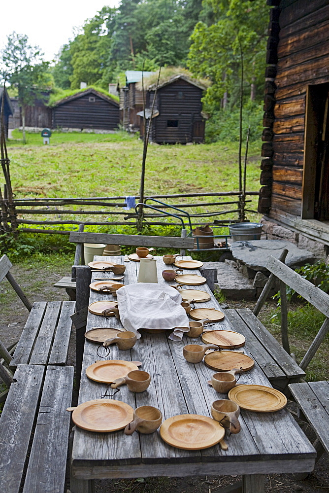 Historic table setting with wooden tableware in the Norsk Folkemuseum (Norwegian Museum of Cultural History), Bygdoy, Oslo, Norway, Scandinavia, Europe