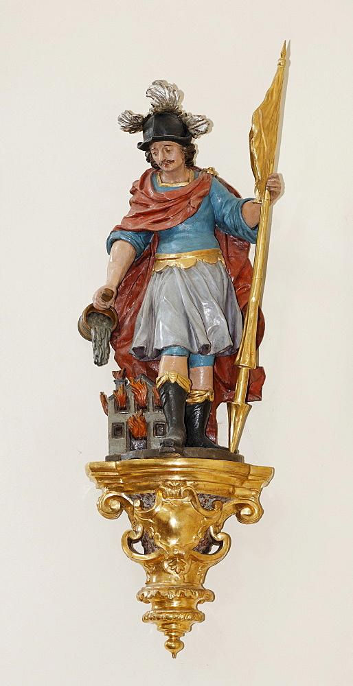 Statue of St. Florian (Florian of Lorch) at the parish church in Schoengau, Triestingtal, Lower Austria, Austria