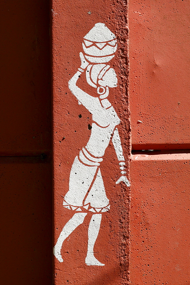 Decoration on a wall, woman carrying jar on the head, Cape Town, South Africa