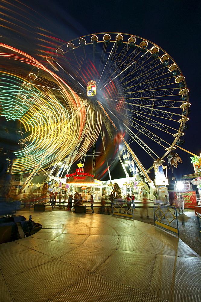 Giant wheel and carousel by night, funfair, Waldkraiburger Dult, Waldkraiburg, Upper Bavaria, Bavaria, Germany