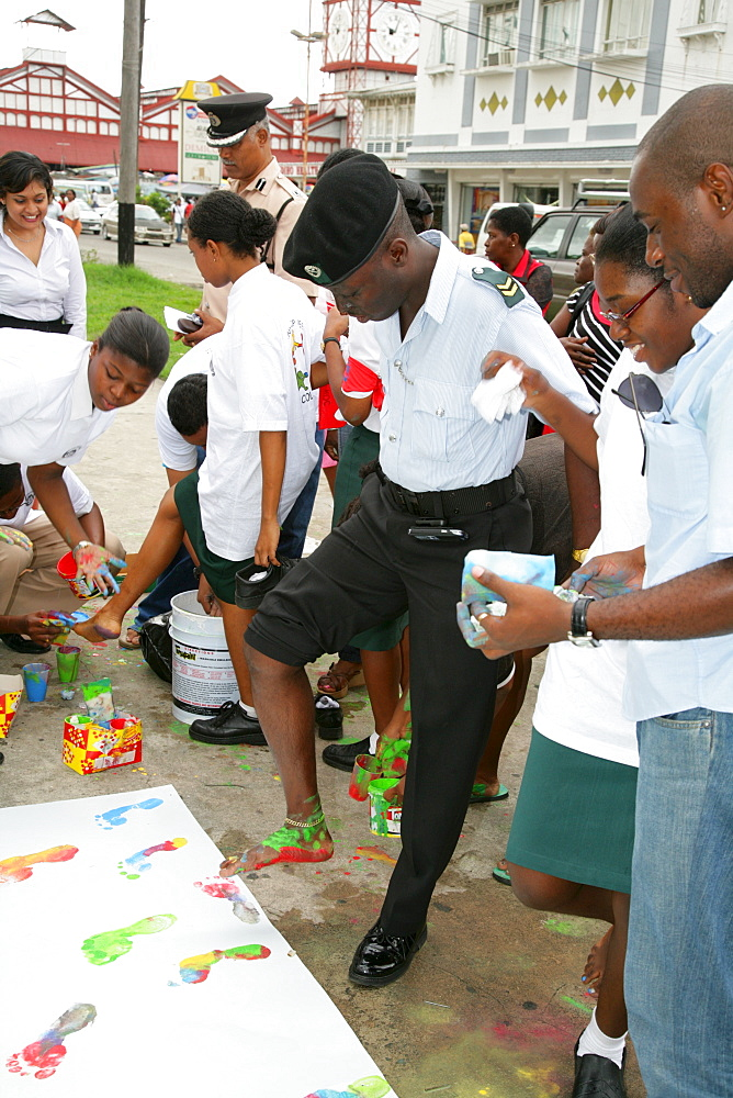Colourful footprints to symbolize diverse ethnic backgrounds, protesting violence against women, in Georgetown, Guyana, South America