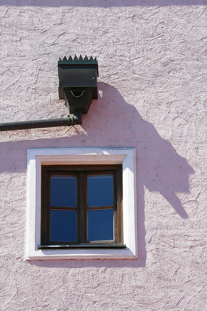 Window and eaves trough on a building facade in Muehldorf am Inn, Upper Bavaria, Bavaria, Germany, Europe