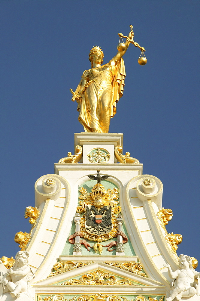 Statue of Justice with scales and sword on the gable of the courthouse in Bruges, Flanders, Belgium, Europe