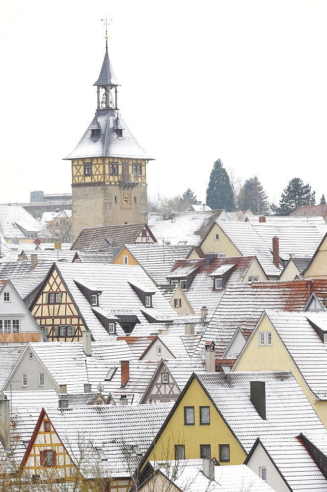 View over snow dusted rooftops, timber framed houses and Upper Gate Tower of the historic centre of Marbach am Neckar, Baden-Wuerttemberg, Germany