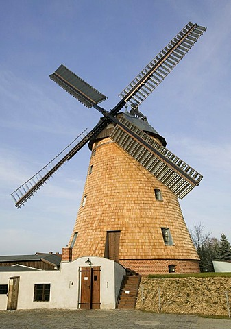 Straupitz in the Spreewald, DEU, 13.11.2005: Dutch windmill in Straupitz, a technical monument of 1910. In the historical oil mill Klaus Rudolph produces linseed oil.