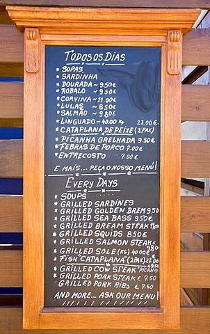 Menu outside a restaurant in Armacao de Pera, Algarve, Portugal, Europe