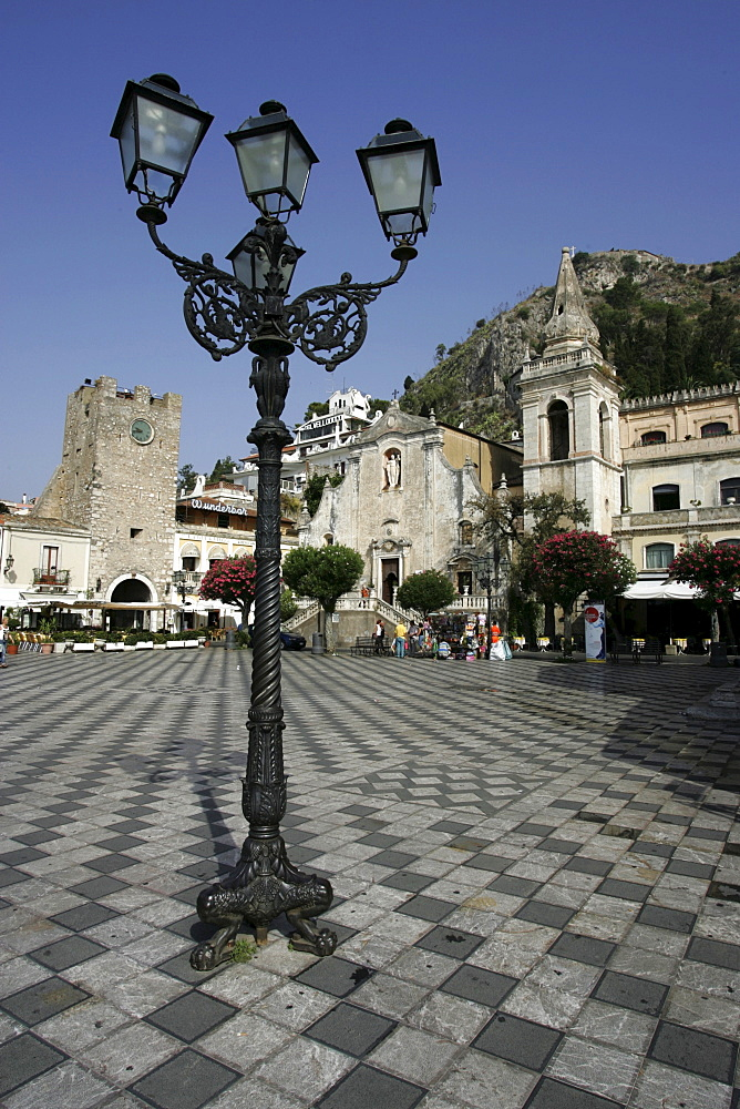 """ITA, Italy, Sicily : The town of Taormina, in the northeast of the island. Square """"Piazza 9 Aprile"""", at the shopping street Corso Umberto I. Torre dell'Orologio, left, Church Chiesa di San Giuseppe 