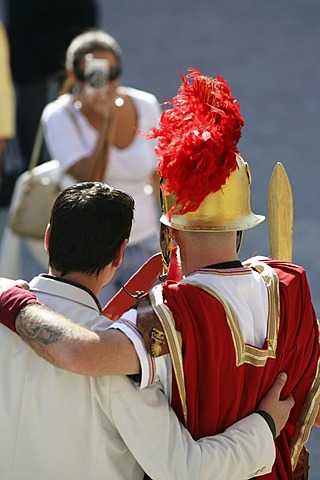 ITA, Italy, Rome : Tourist takes a photo with a roman soldier actor. |