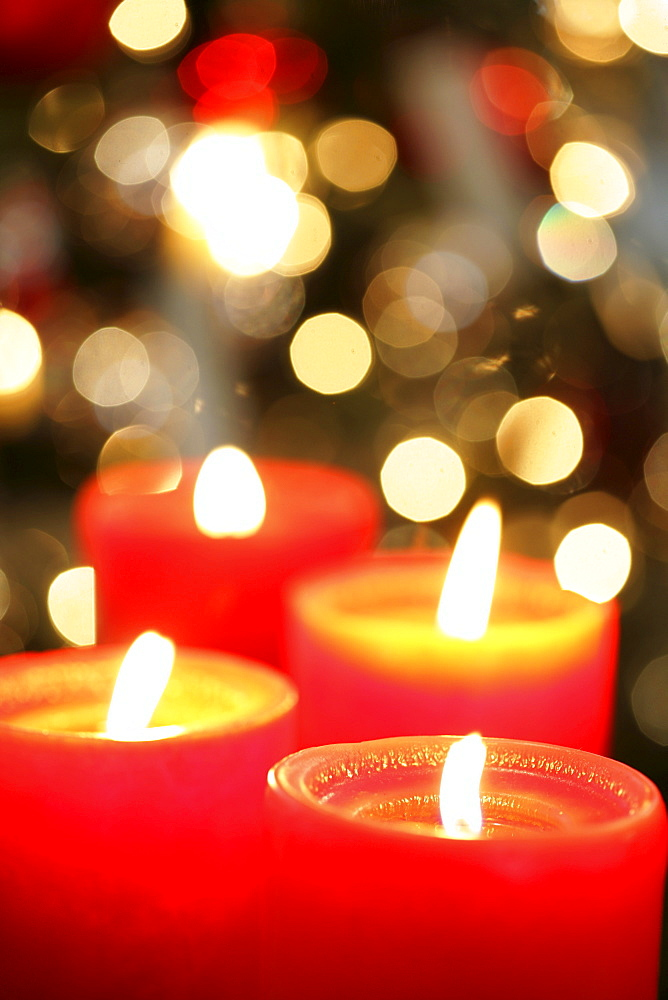Christmas decoration. Lit candles.|