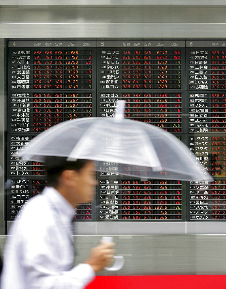Stock exchange information displays at a bank in the Nihombashi financial district, Tokyo, Japan, Asia