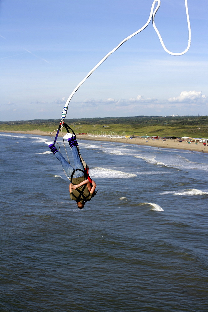 Bungee Jumping from the pier over the North Sea, Scheveningen, The Hague, The Netherlands, Europe