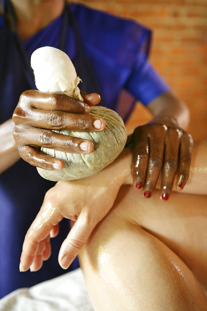 Hand massage using herb pouches, Somatheeram Ayurveda Resort, traditional Ayurvedic medicine spa resort in Trivandrum, Kerala, India, Asia