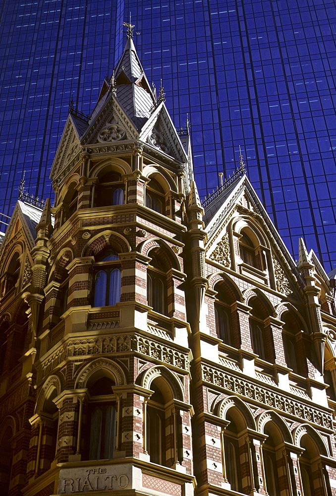 The Rialto Hotel in front of the glass facade of the Rialto Towers in Melbourne, Victoria, Australia