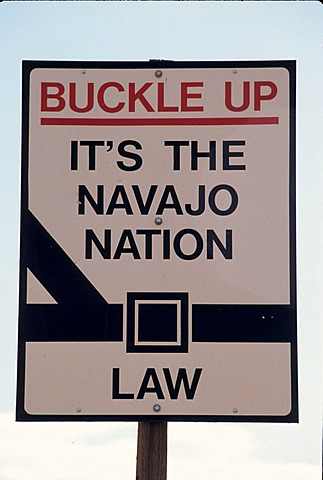 USA, United States of America, Arizona: Roadsign to buckle up while driving.